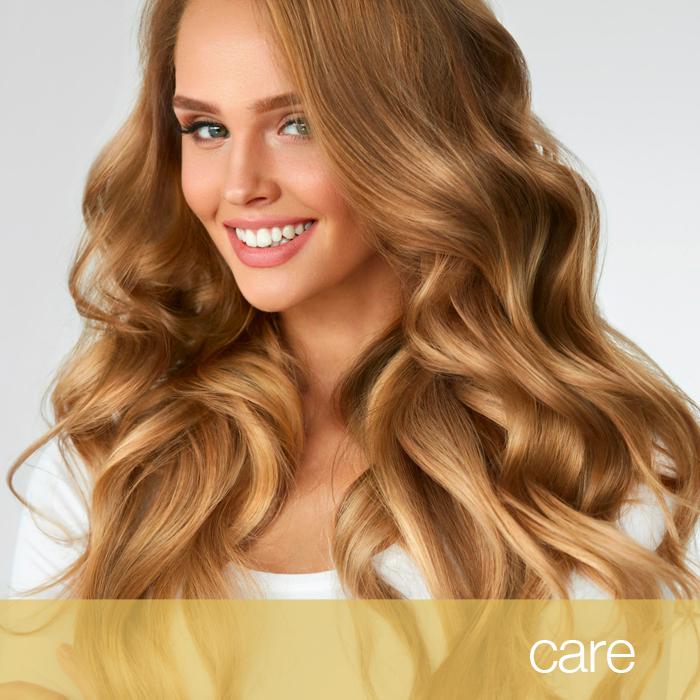 Ragazza capelli luminosi biondi, prodotti cura capelli
